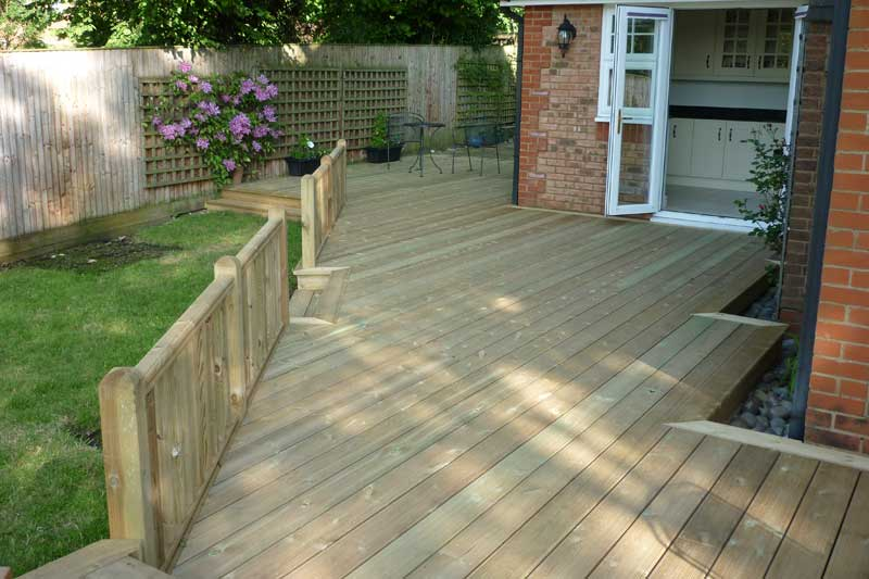 Allscapes decking carpentry for Garden decking before and after